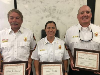 Fire trio honored 25 years