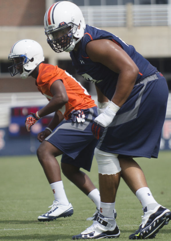 AUBURN FOOTBALL: Chad Slade goes back to work after receiving ...