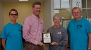 SOS Animal Shelter presents plaque to Mitchell Nissan