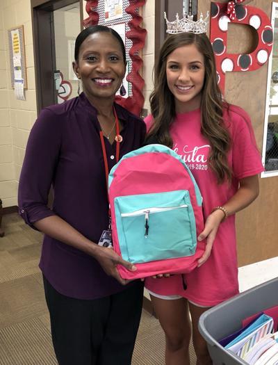 Queen helps collect supplies for school