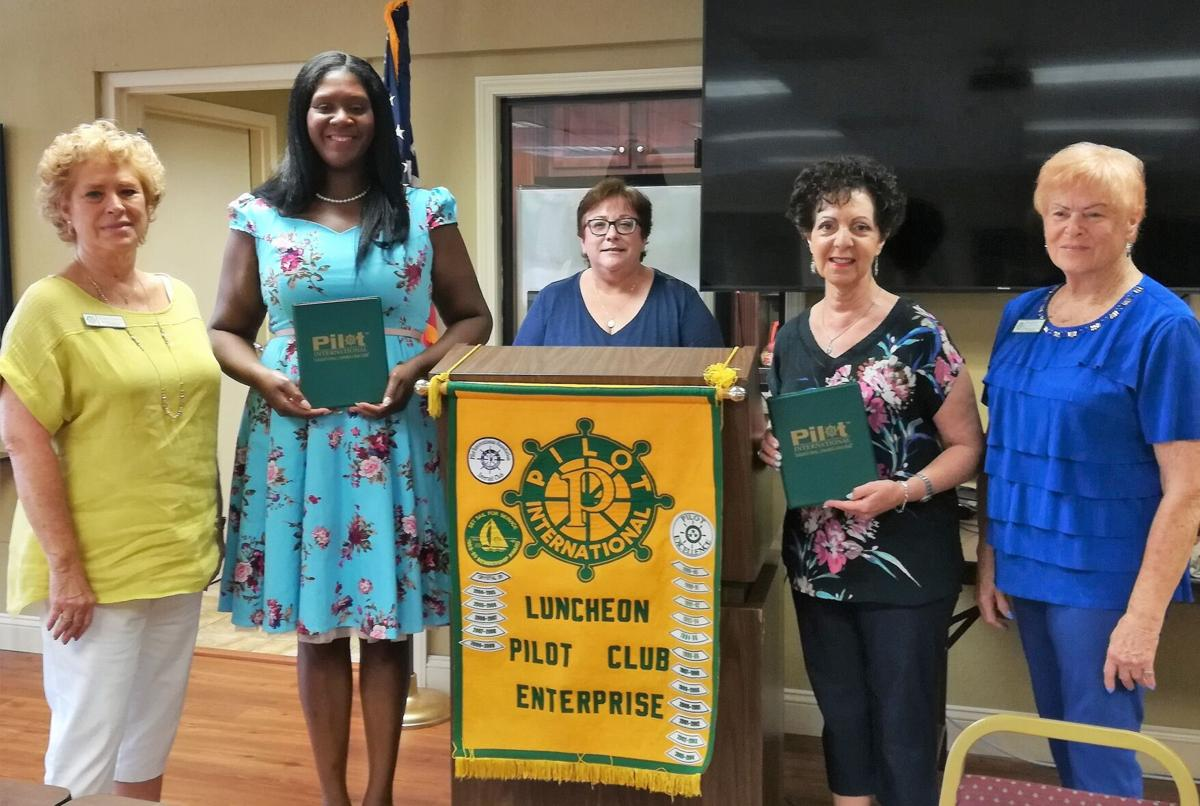 Luncheon Pilot Club installs two new members