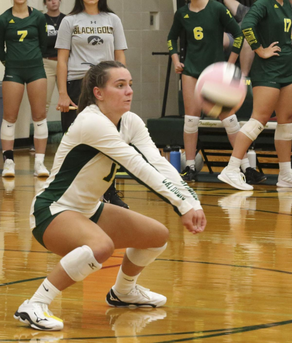 Olivia Hogan has her eye on the ball while returning serve.