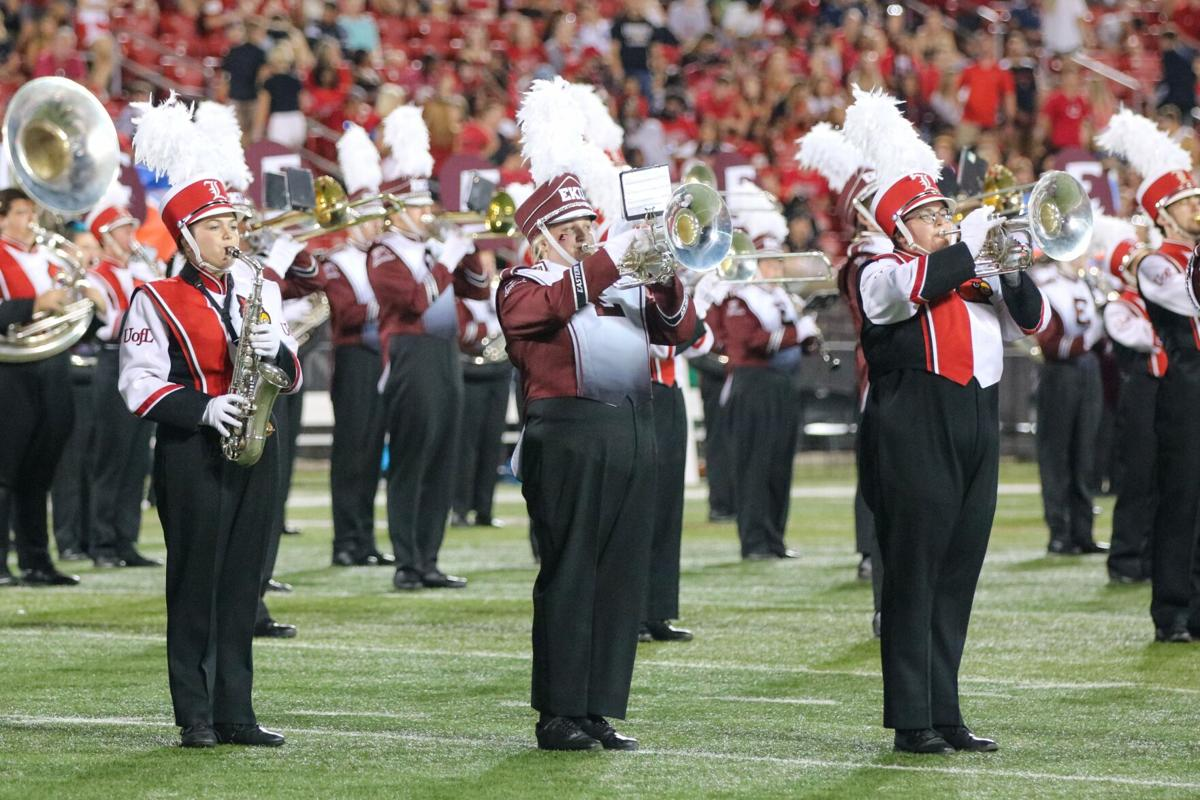 PHOTOS: Marching Colonels join Marching Cardinals for halftime performance