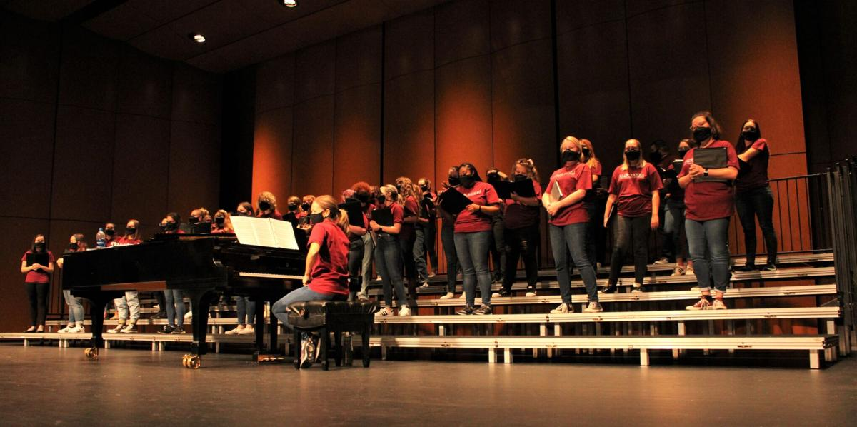 EKU's EnChor group practices before their performance for students and visitors.