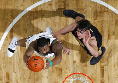 Ward scores 26, No. 10 Spartans top No. 18 Iowa 90-68