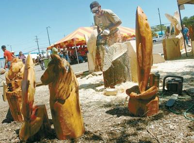 Logs take shape at chainsaw carving event local news