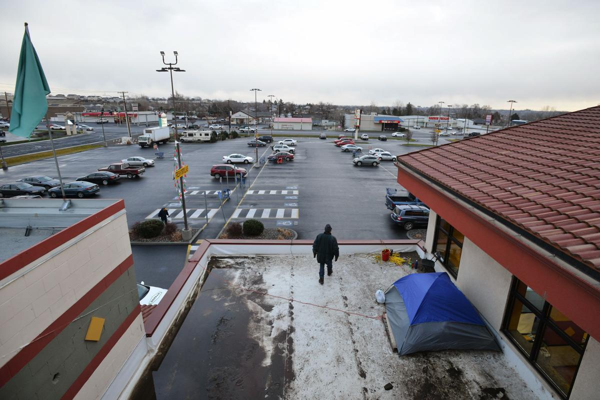 Hermiston La Ley manager camping on Fiesta Foods roof