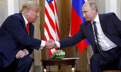 The Latest: Putin says if US builds missiles, so will Russia