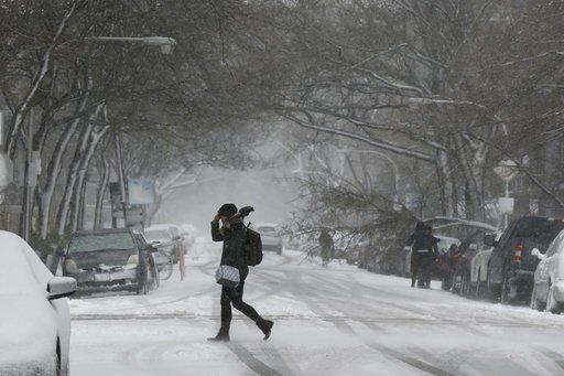 Slick roads, blowing snow delay air, road travel in Midwest