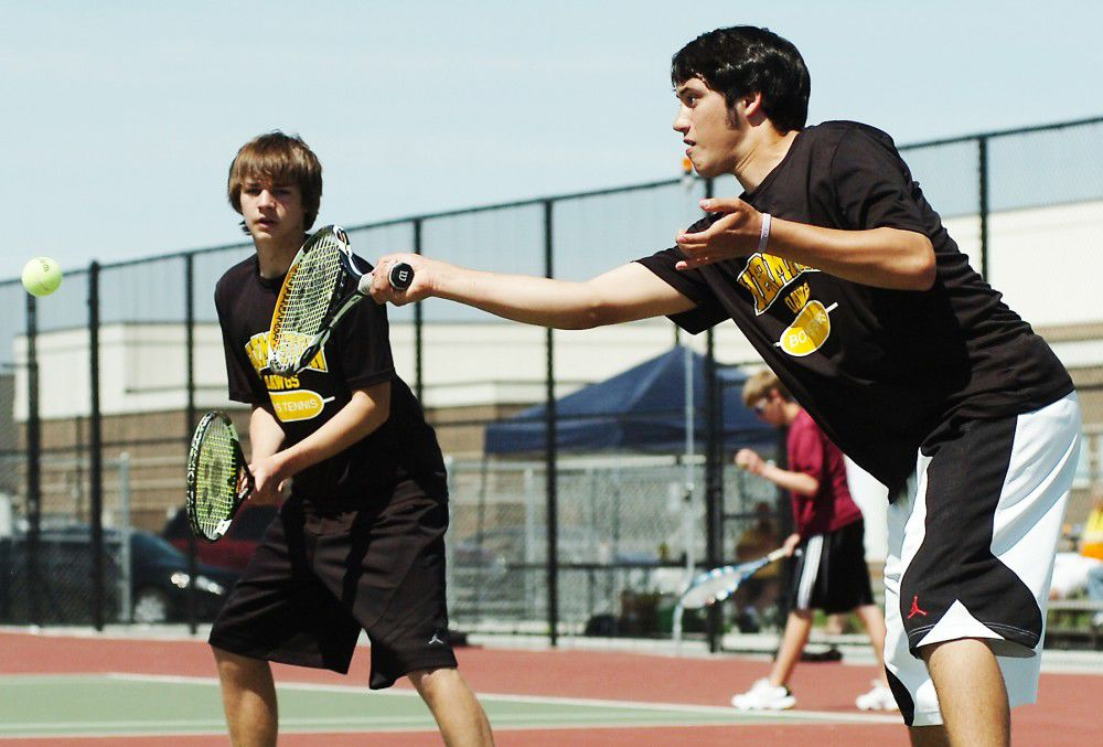 PREP TENNIS: Storm tears through early rounds