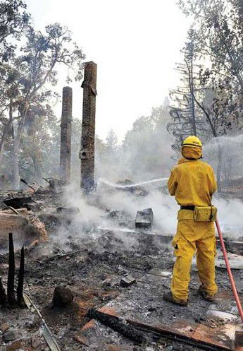 Wildfire burns Ashland home