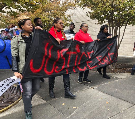 Police shooting protest blocks road as mayor urges patience