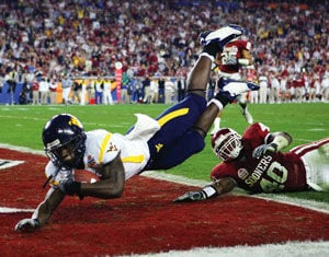 White leads Mountaineers to Fiesta Bowl win