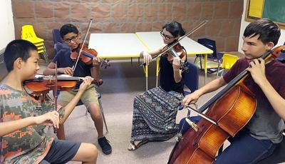 Strings camp crescendos with free concert