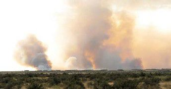 1,000s of acres burn at depot