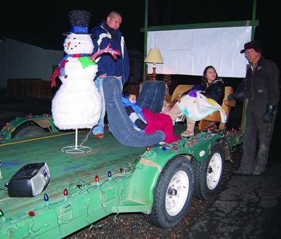 Parade lights up holiday season
