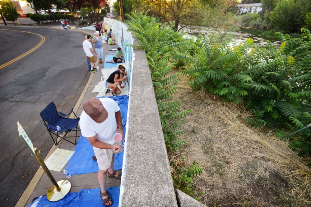 Artists come together to beautify the river parkway
