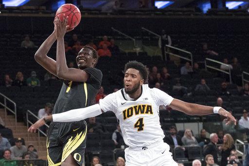 The Latest: Iowa tops No. 13 Oregon 77-69