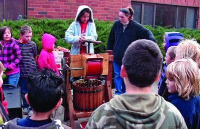 Class takes turn at making cider