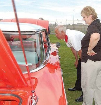 Classic cars cruise inside for show