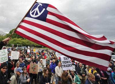 Anti-corporate protesters rally in Salem