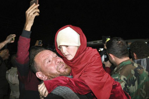 Ex-IS captive says son died in her lap from militant fire