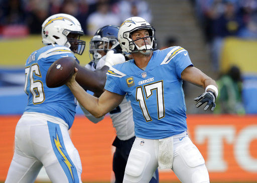 Miller embraces Rivers after becoming friends at Pro Bowl