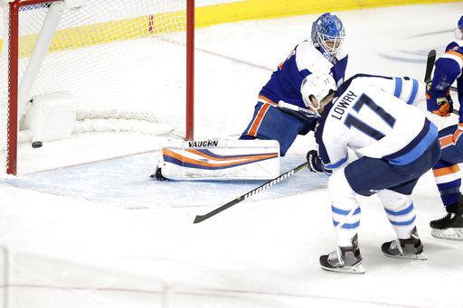 Trouba, Lowry rally Jets to 3-1 win over Islanders