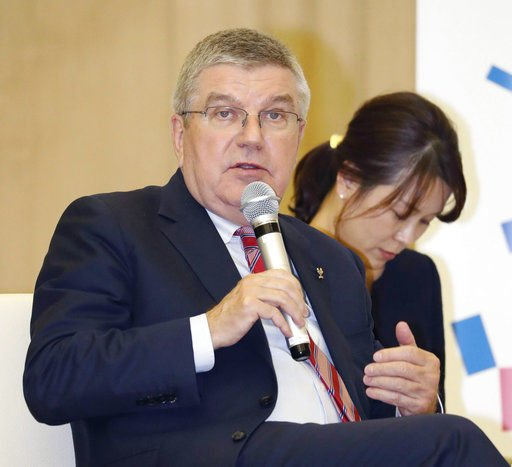 Olympic-related meetings overshadowed by corruption charges