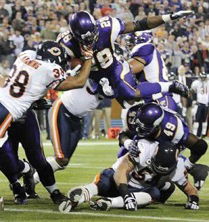 Peterson gets going late, leads Vikings past Bears