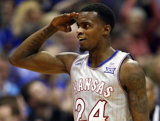 Vick goes 8 of 8 from 3 as No. 2 Kansas wears down Vermont