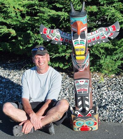 Local kayaker wins carved totem