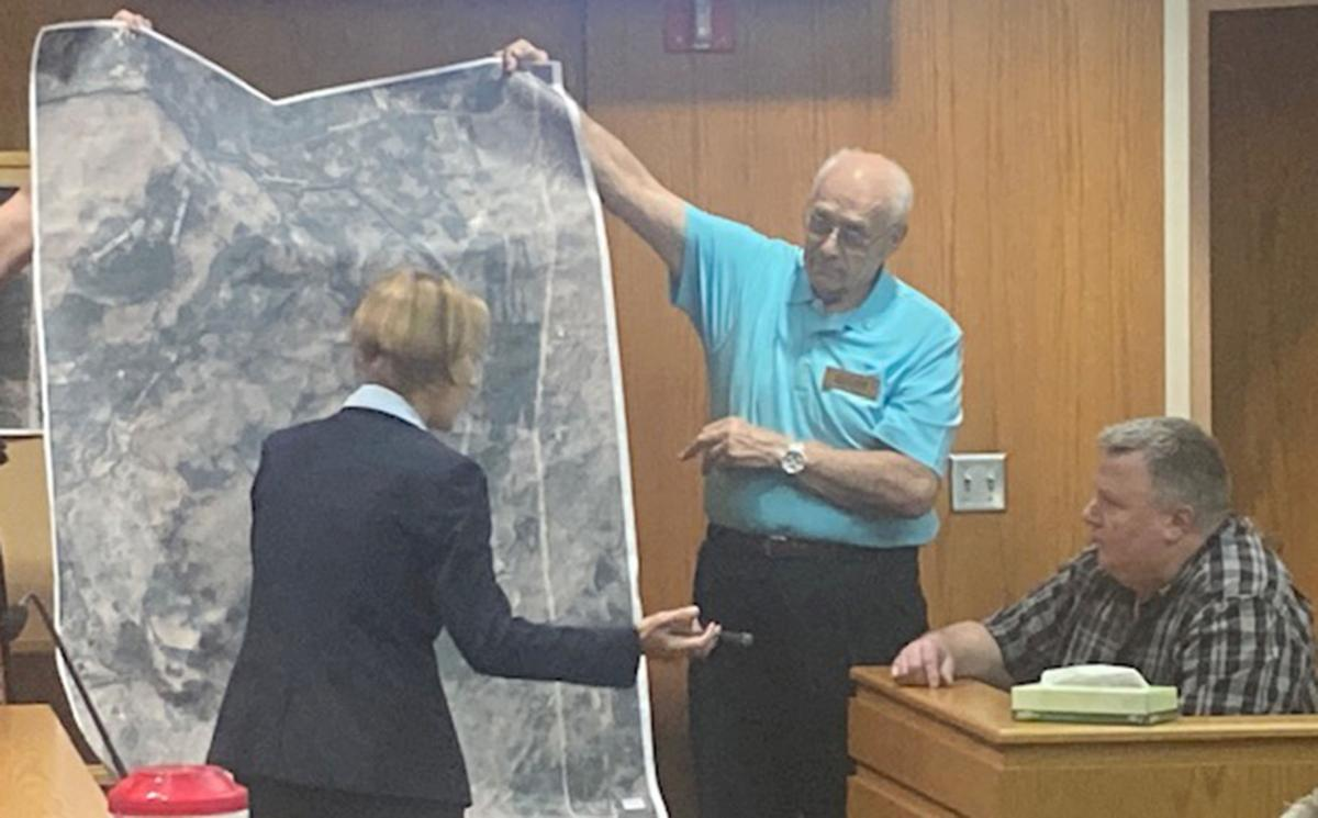DeShea Morrow with map