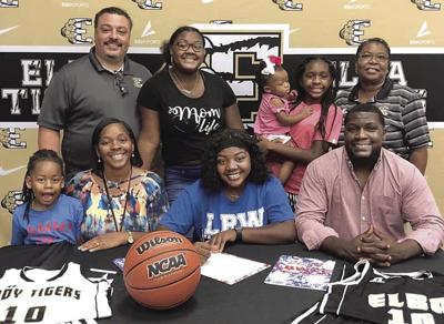 Whitfield signs basketball scholarship