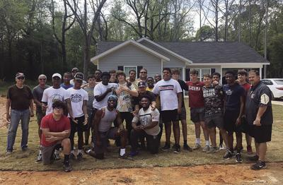 football players at habitat house