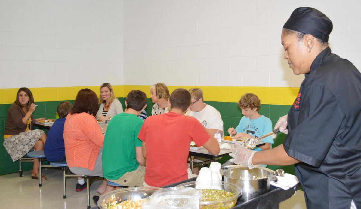 Students try out new recipes during Lunch with Principal