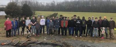 Volunteers plant trees at Camp Blount