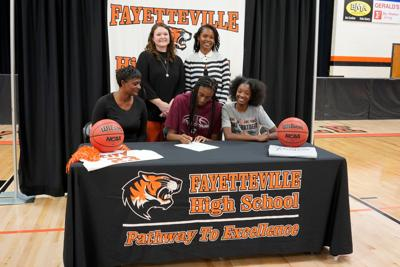 Robinson first Lady Tiger to sign D1 scholarship