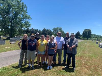 VFW members and volunteers clean veterans' headstones