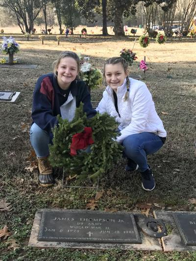 Wreaths are offered to honor local veterans