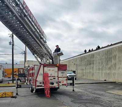 Injured worker rescued from roof