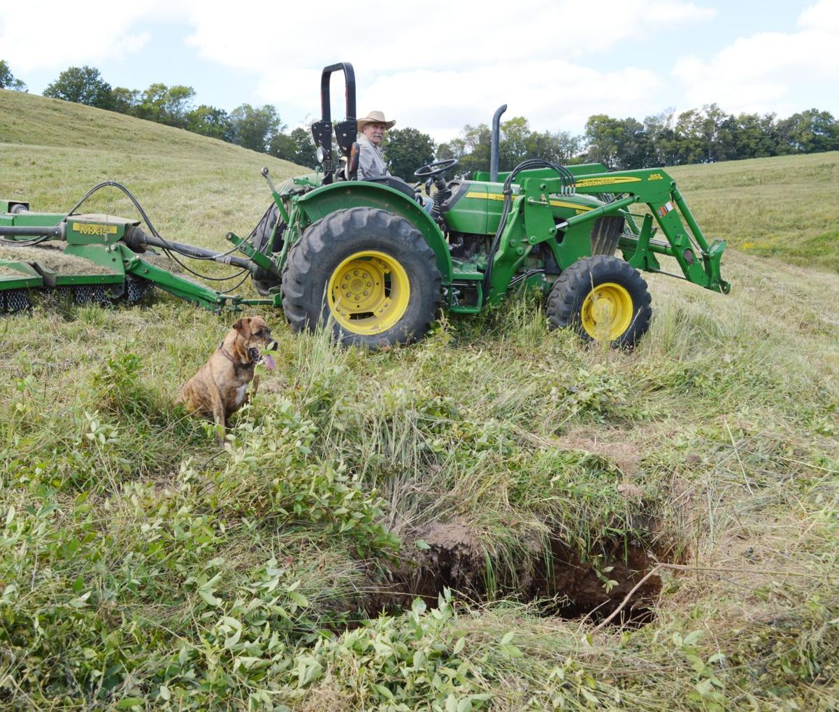 Sinkhole nearly swallows tractor