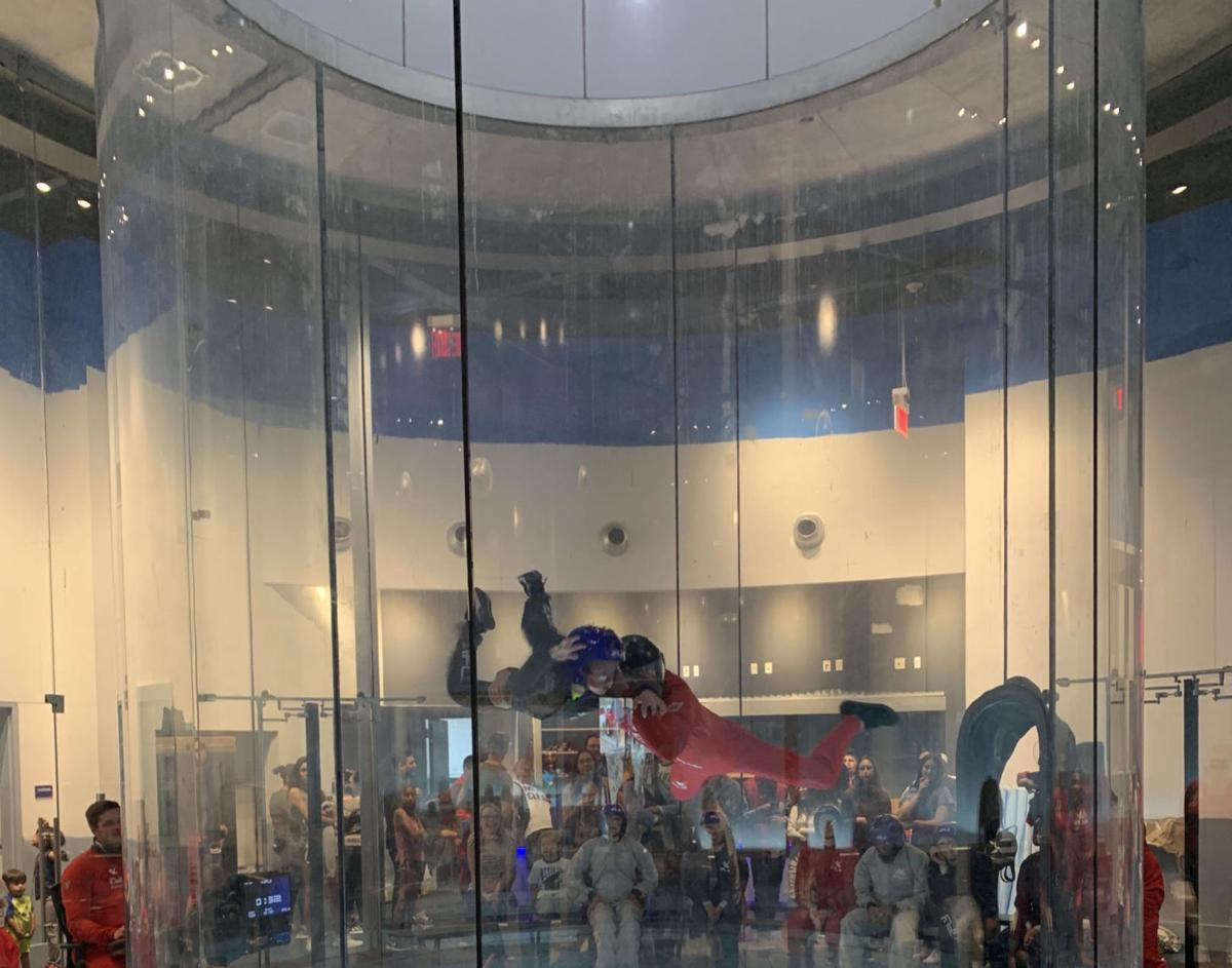 iFly instructor Eric Jackson flies with a customer