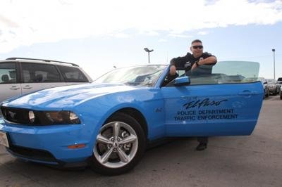 Officer Sergio Cordova and the Police Department's new blue Mustang.