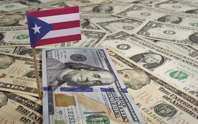Flag of Puerto Rico sticking in various american banknotes.(seri