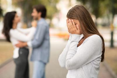 Upset woman crying, seeing her boyfriend with other girl
