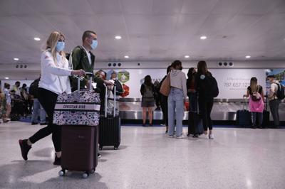 Viajeros, Aeropuerto, Covid-19, coronavirusl