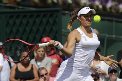 En acción Mónica Puig en el Wimbledon