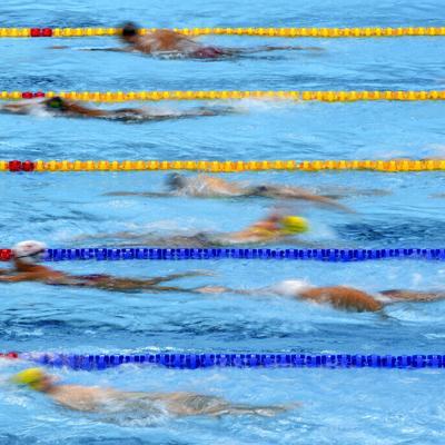 El caos organizado del calentamiento en la piscina olímpica