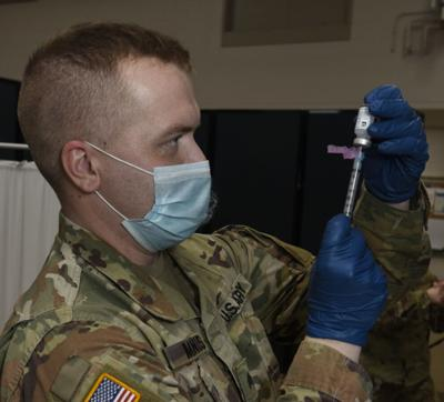 National Guard giving vaccine